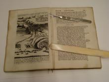 Cutting the original sewing in order to 'pull' the book.
