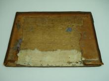 Original wooden board with remaining brass fittings.