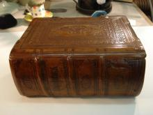 Finished reback, original spine relaid.