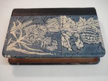 Quarter leather binding, morocco spine with block printed paste paper sides.